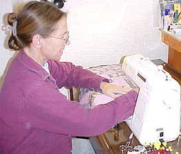 Cindy sewing the quilt pieces into blocks