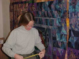 Cindy in the studio, designing a quilt