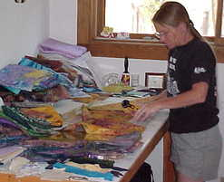 Cindy working in the studio making a quilt